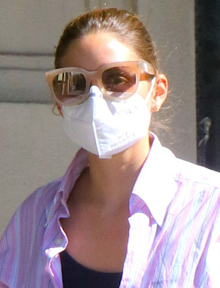 Olivia Palermo prevents coronavirus spread with a face mask