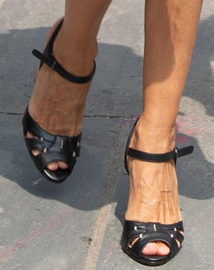 Sarah Jessica Parker slips into a pair of SJP peep-toe sandals