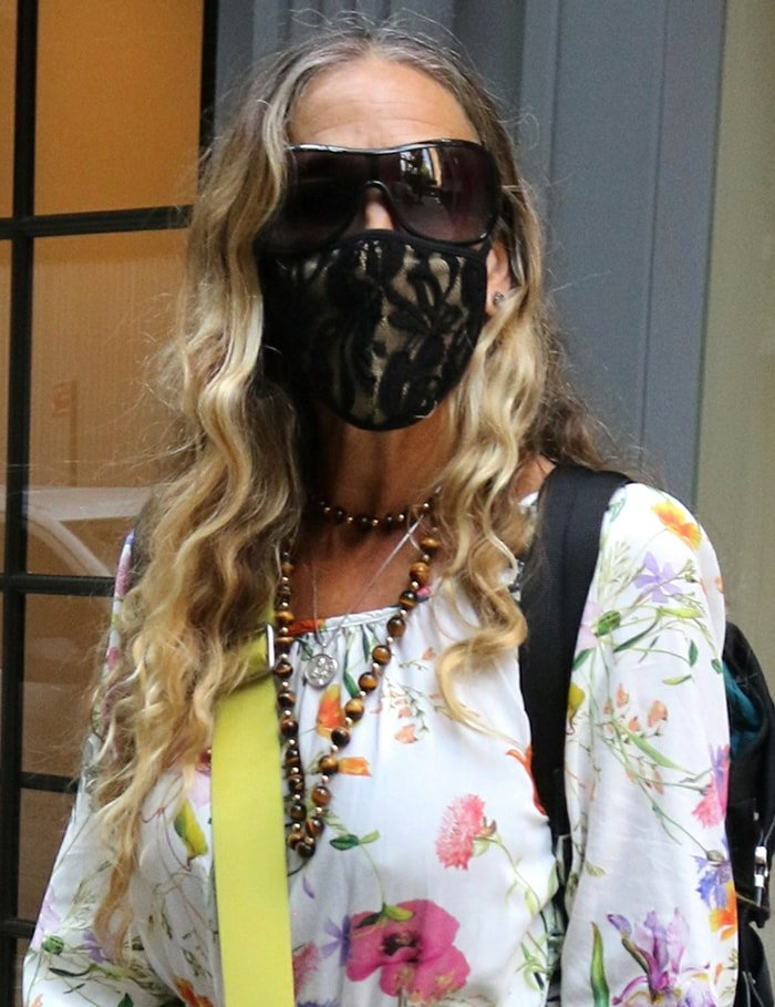 Sarah Jessica Parker wears her SJP x Sunglass Hat sunnies and Masqd laced face mask