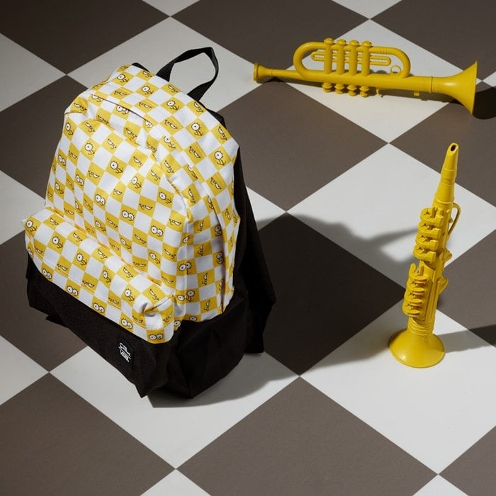 Fun school backpack with a partial checkerboard print showcasing the Simpson family's eyeballs