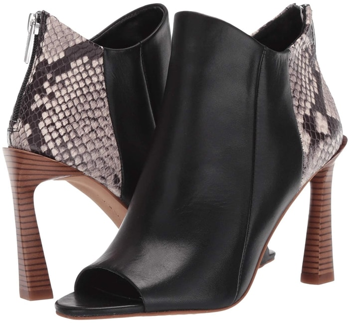 The black Vince Camuto Aritziana bootie features a chic open-toe silhouette and has a zip closure at the heel for easy on-and-off wear