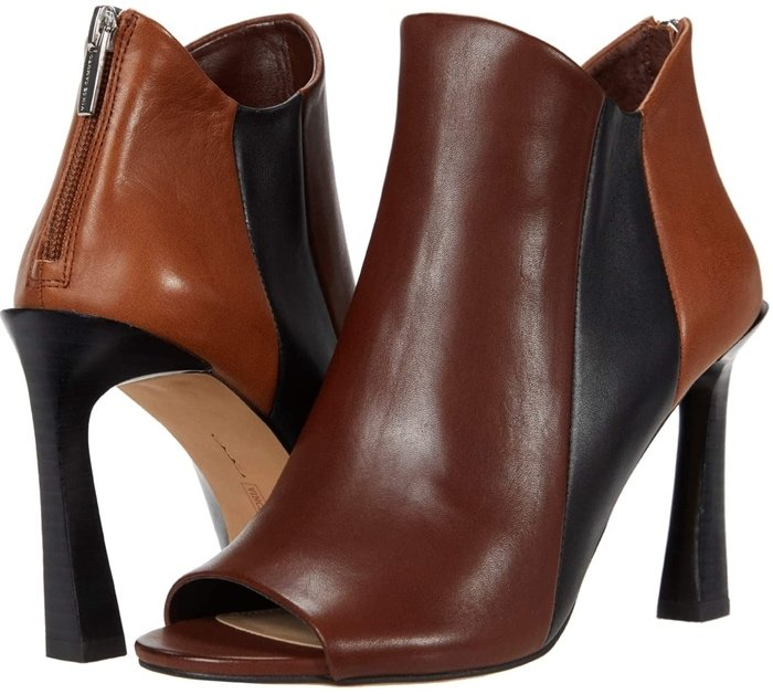 The brown Vince Camuto Aritziana bootie features a chic open-toe silhouette and has a zip closure at the heel for easy on-and-off wear