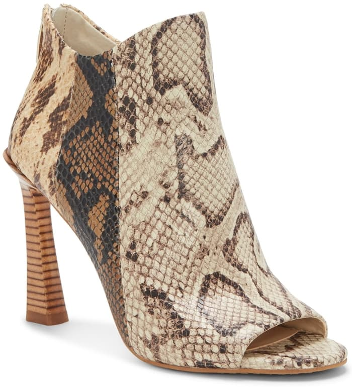 The snake print Vince Camuto Aritziana bootie features a chic open-toe silhouette and has a zip closure at the heel for easy on-and-off wear