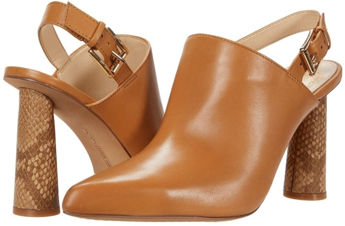 The peanut leather Vince Camuto Korling heeled sandal has a leather upper that boasts an adjustable buckle closure and a pointed toe