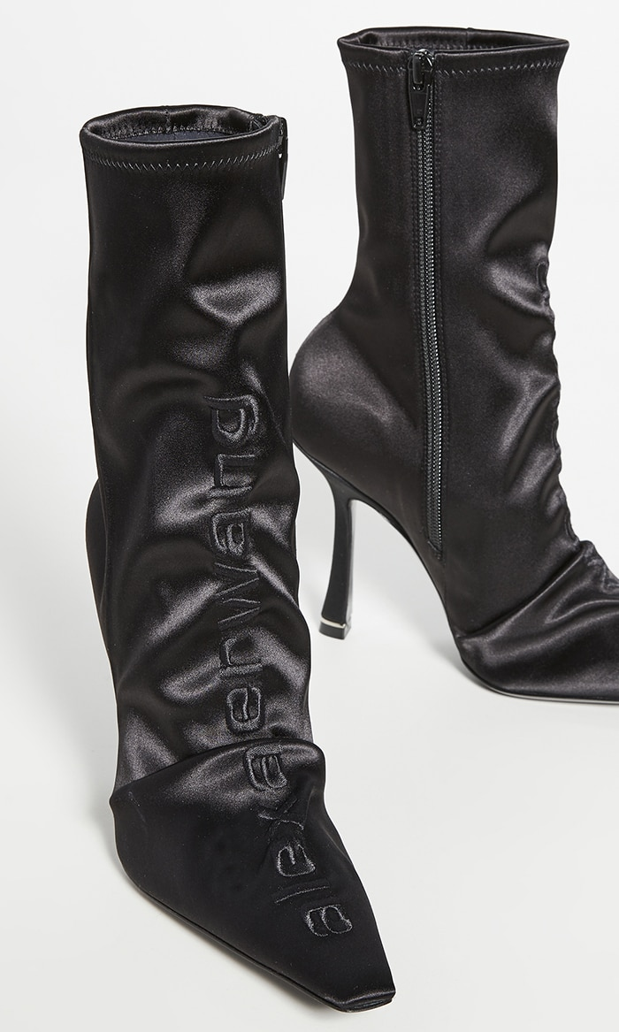 Black leather and satin Vanna pointed boots from Alexander Wang featuring a pointed toe, an ankle length and a mid-heel