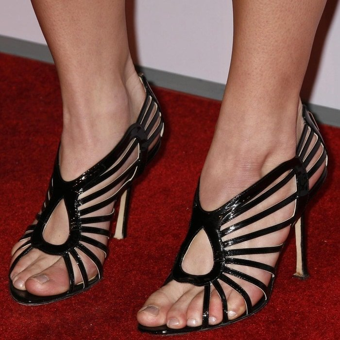 Ashley Greene shows off her perfect feet in strappy high heels