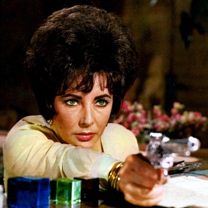 Elizabeth Taylor's role as Martha Pineda in The Comedians, a 1967 American political drama film directed and produced by Peter Glenville, was originally intended for Sophia Loren