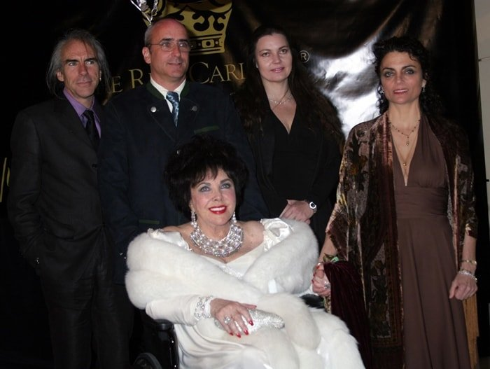 Dame Elizabeth Taylor arrives with her children, (L-R) Michael Wilding Jr., Christopher Wilding, Maria Burton, and Liza Todd Burton, for Taylor's 75th birthday party at the Ritz-Carlton