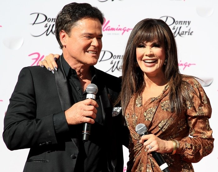 Entertainers Donny Osmond (L) and Marie Osmond arrive at the unveiling of their star from the Las Vegas Walk of Stars