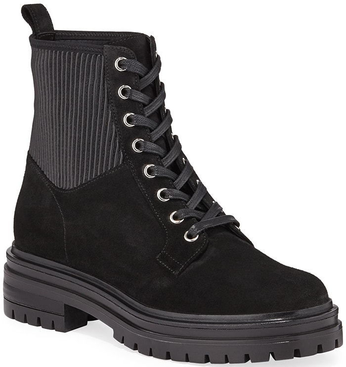 Edgy combat boots merge a smooth leather construction with rib-knit inserts
