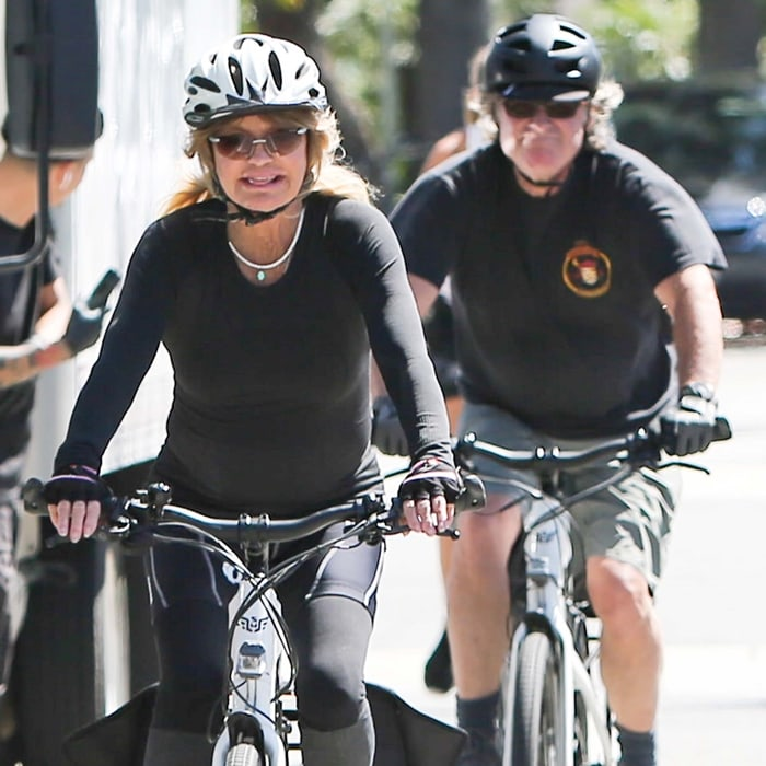 Goldie Hawn and Kurt Russell go for a bike ride in Los Angeles