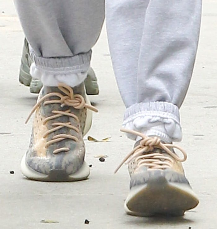 Hailey Bieber completes her look with Adidas Yeezy 380 sneakers