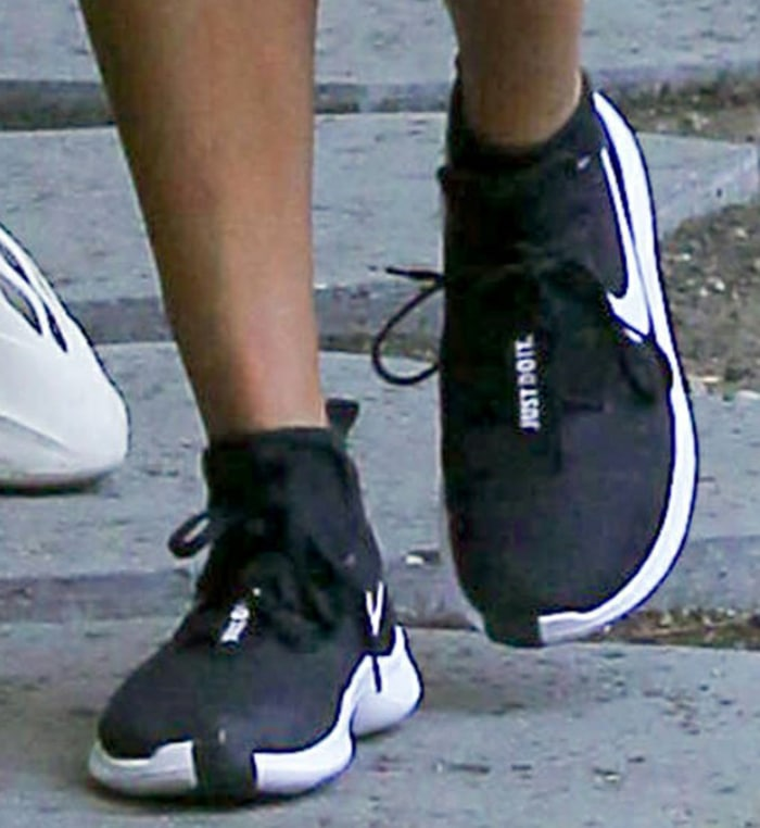 Hailey Bieber completes her casual look with Nike Tr8 shoes