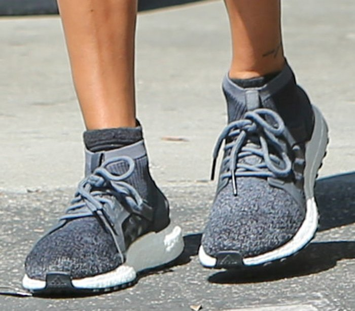 Hailey Bieber teams her athleisure look with Adidas Ultraboost X All Terrain shoes