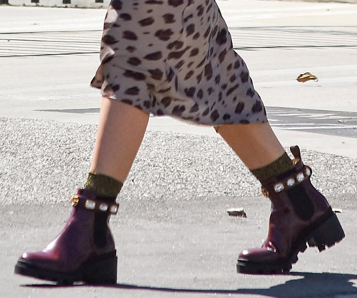 Hilary Duff slips into a pair of bejeweled Gucci boots