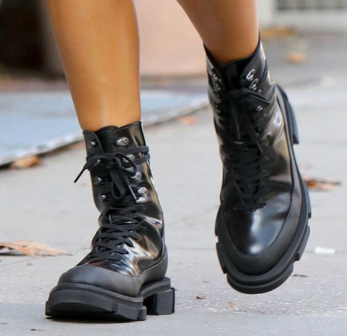 Irina Shayk teams her mini dress with Both combat boots