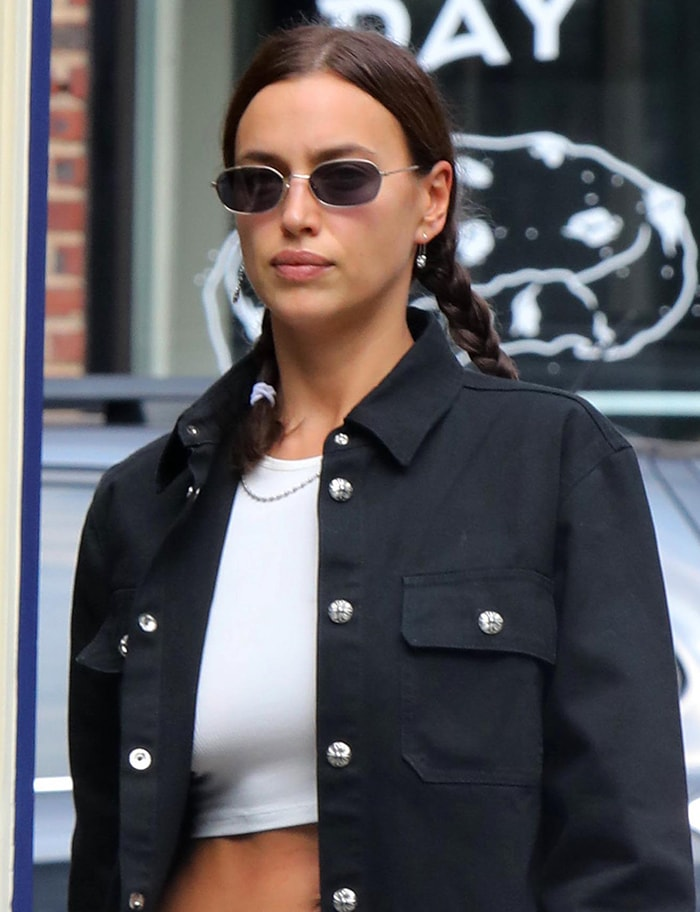 Irina Shayk wears braided pigtails and muted pink lipstick
