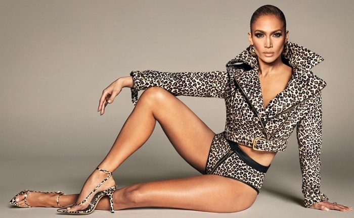 Jennifer Lopez rocks a leopard print jacket with matching hot pants and lucite ankle-strap Parlata high heels