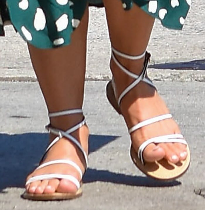 Julianne Hough shows off her feet in white strappy flat Amanu sandals