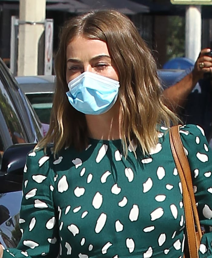 Julianne Hough wears a disposable face mask and styles her loose in natural waves
