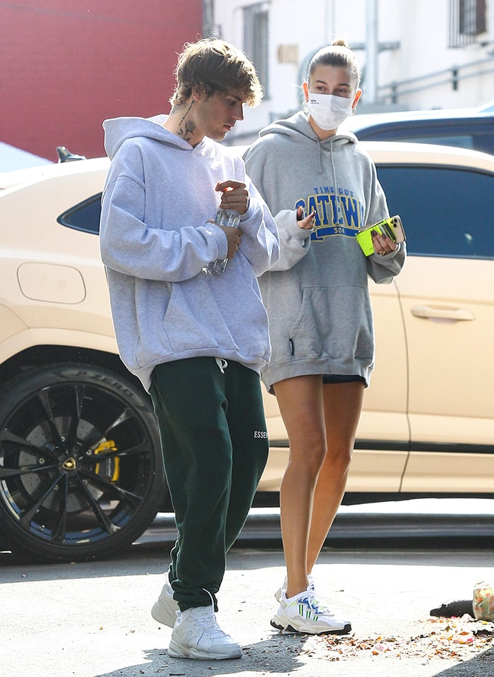 Hailey Bieber puts on a leggy display in tiny shorts underneath her Vetements hoodie