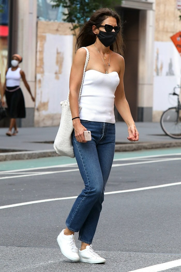 Katie Holmes embraces style icon status in a white strapless bustier top and a pair of jeans