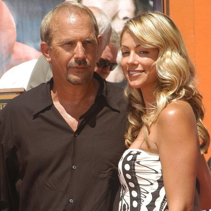 Kevin Costner and wife Christine Baumgartner at his hand and footprint ceremony honoring him