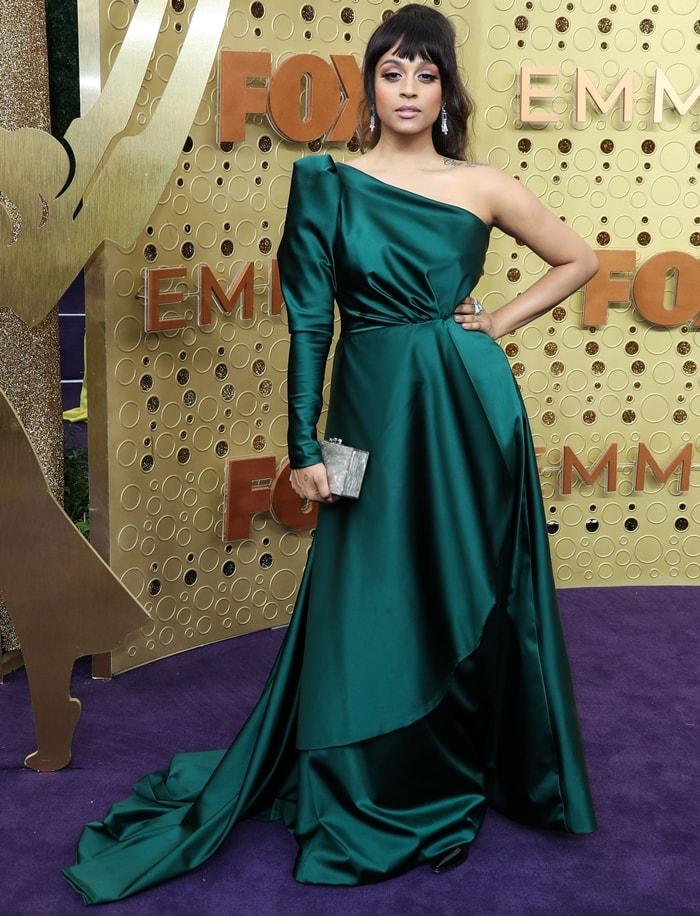 Lilly Singh wore a custom dark green Kimberly Park one-shoulder dress