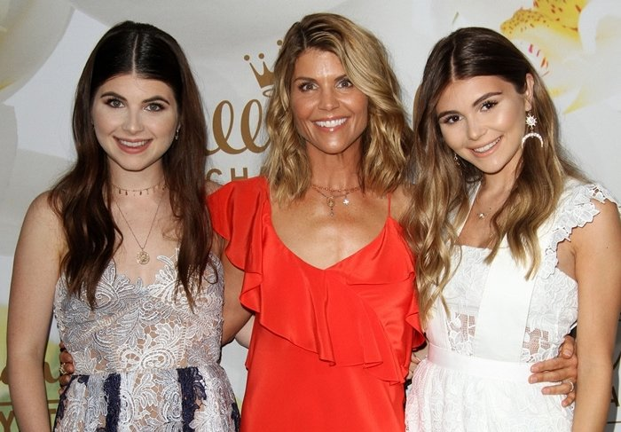 Actress Lori Loughlin (C) and her daughters Isabella Rose (L) and Olivia Jade Giannulli (R)