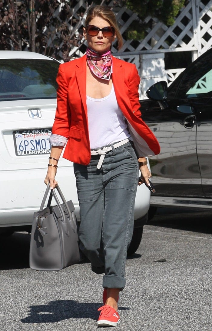 Lori Loughlin pairs a bright orange blazer with equally bright sneakers