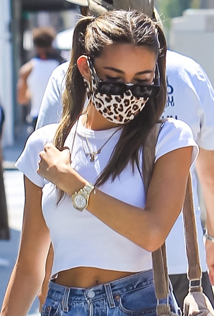 Madison Beer wears pigtails and a leopard face mask