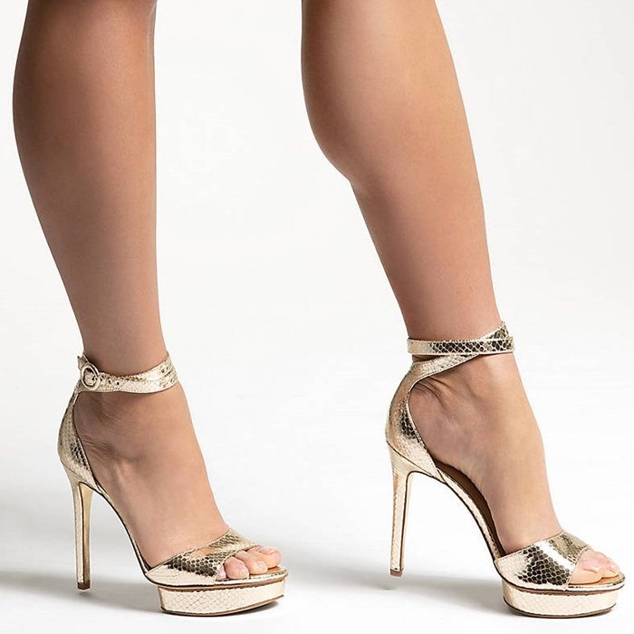 Glam metallic and a towering heel make these JLO JENNIFER LOPEZ sandals the can't-miss pair in your night-out lineup