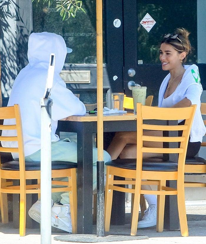 TikTok star Nick Austin in a white hoodie, mint green sweatpants, and Nike x Off White Air Jordan 1 sneakers