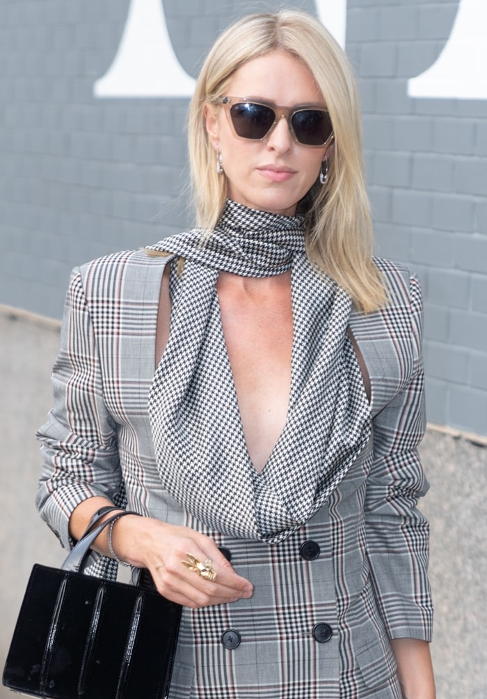Nicky Hilton totes a timeless Max Mara Whitney leather tote with pin-tucked pleats running down the sides