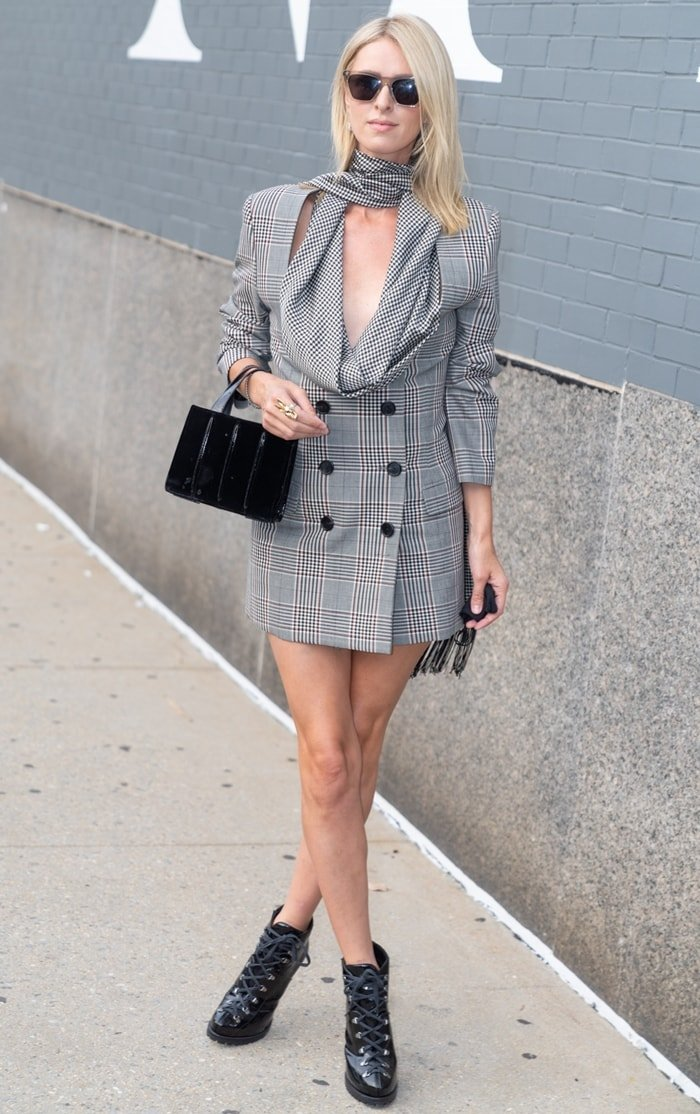 Nicky Hilton flaunts her legs in a cowl neck plaid blazer dress at the Monse Fall/Winter 2020 Shoppable Presentation