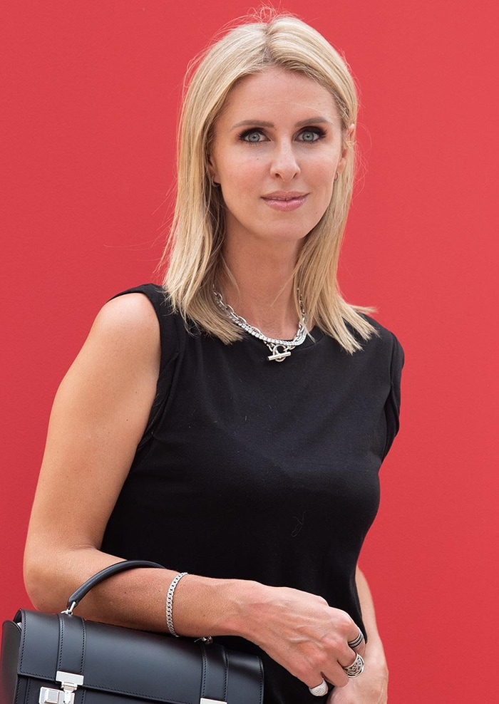 Nicky Hilton styles her blonde hair straight and glams up with smokey eyeshadow