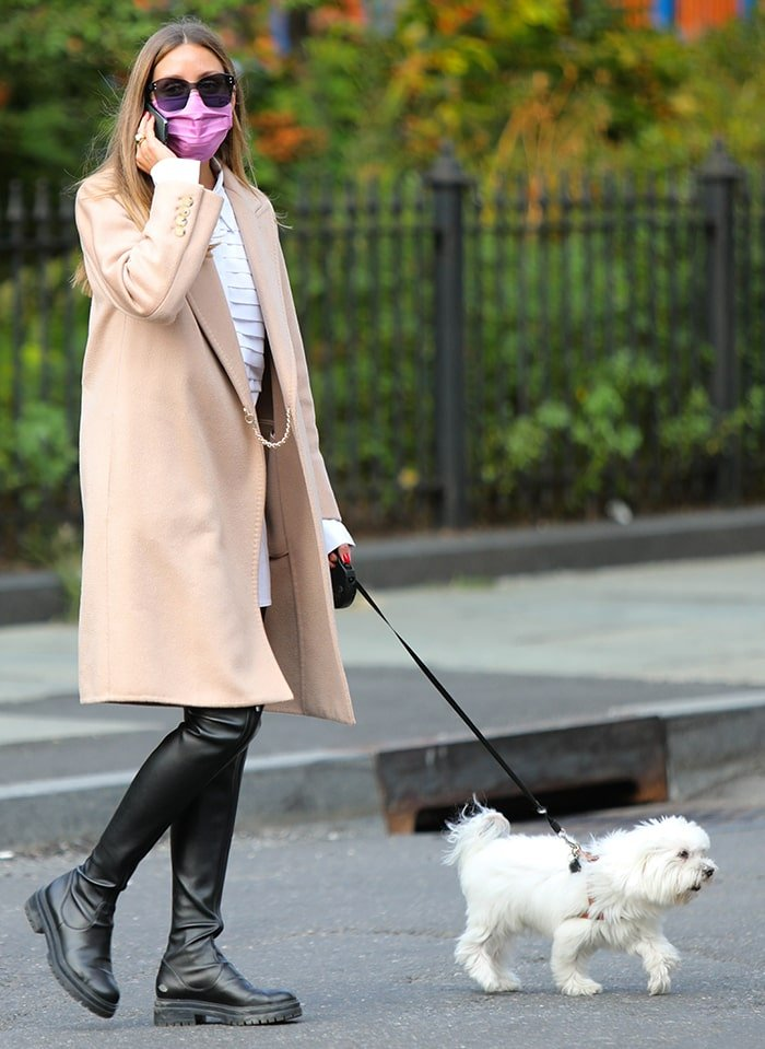 Olivia Palermo is ready for fall in her coat-and-boots combo as she walks her dog in Dumbo, Brooklyn on September 16, 2020
