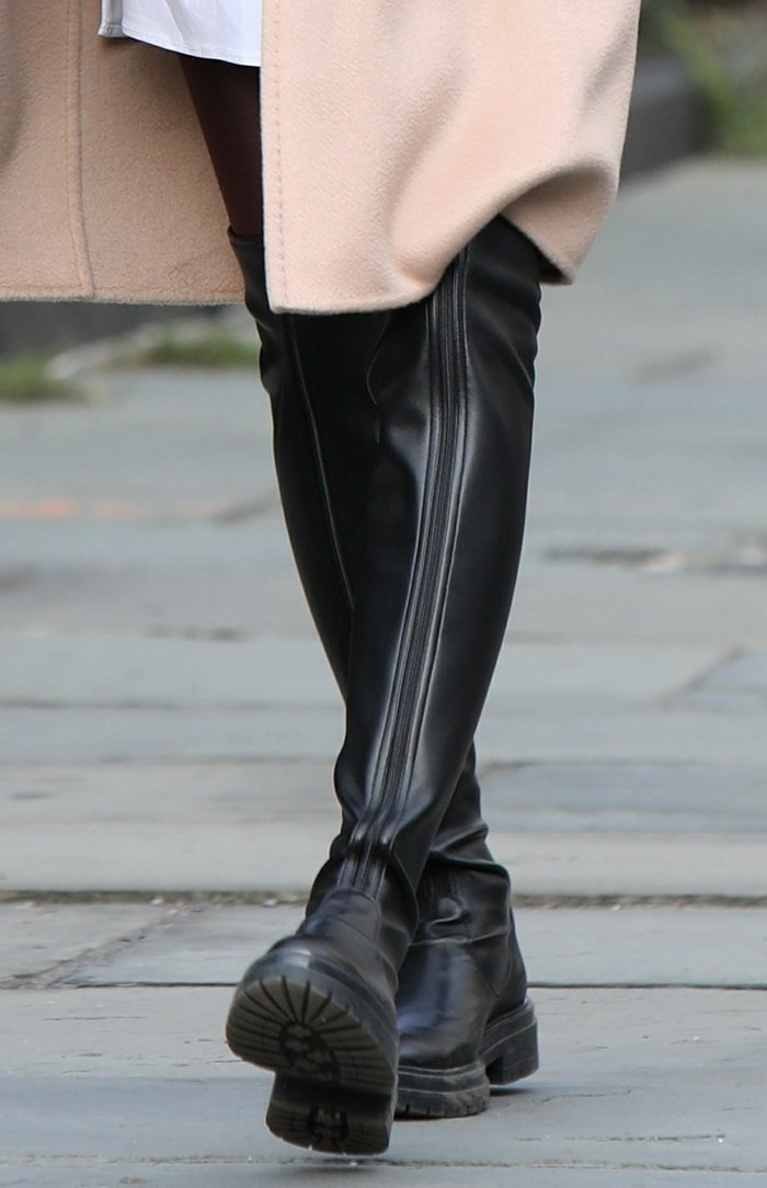 Olivia Palermo completes her fall fashion look with thigh-high leather boots