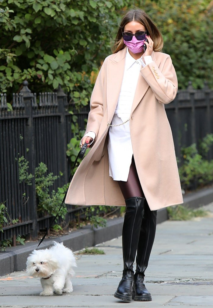 Olivia Palermo wears a beige cashmere Max Mara coat with a white shirtdress and metallic tights