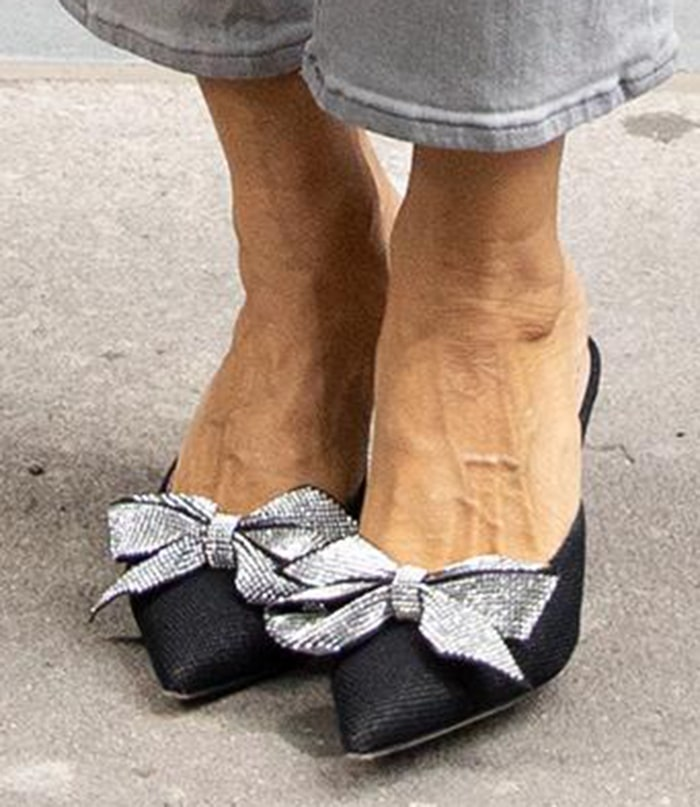 Sarah Jessica Parker completes her gray look with SJP Paley embellished bow mules