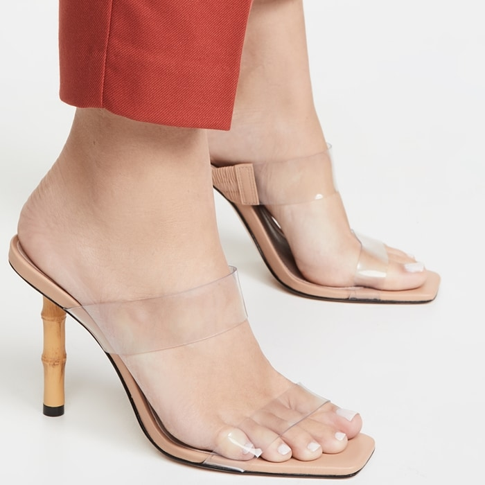 A square toe brings a trendy angle to this stiletto sandal featuring rolled leather straps that arc, intertwine and curve beautifully around the foot