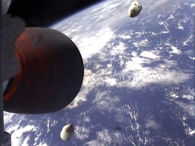 This picture captures the moment internet tycoon Elon Musk's private rocket successfully blasted into outer space – after three aborted missions