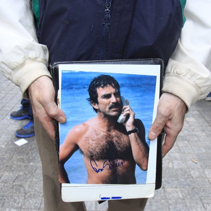 A fan carrying a signed photo of Tom Selleck at PaleyFest NY 2014