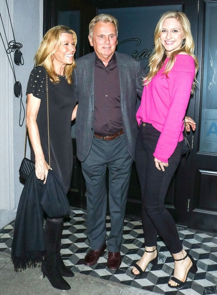Vanna White posing with Pat Sajak and his daughter Maggie Sajak outside Craig's restaurant