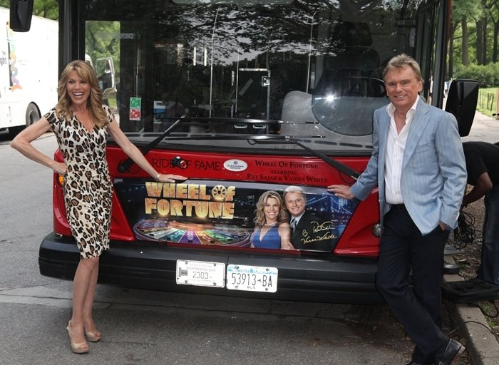The hosts of Wheel of Fortune Vanna White (L) and Pat Sajak are honored by Gray Line New York's Ride Of Fame Campaign