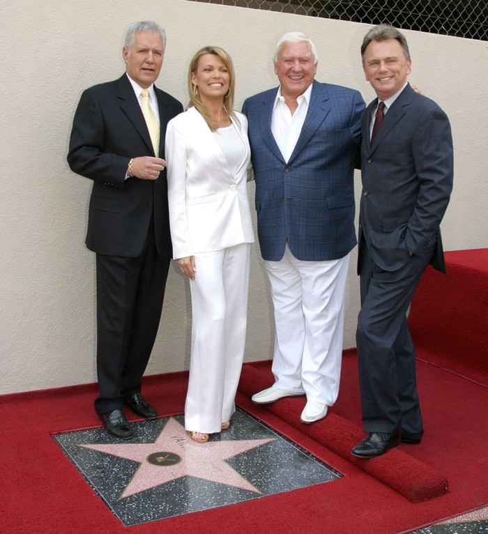 Alex Trebek, Merv Griffin and Pat Sajak joined Wheel of Fortune co-host Vanna White at a ceremony to honor her with the 2,309th star on the Hollywood Walk of Fame