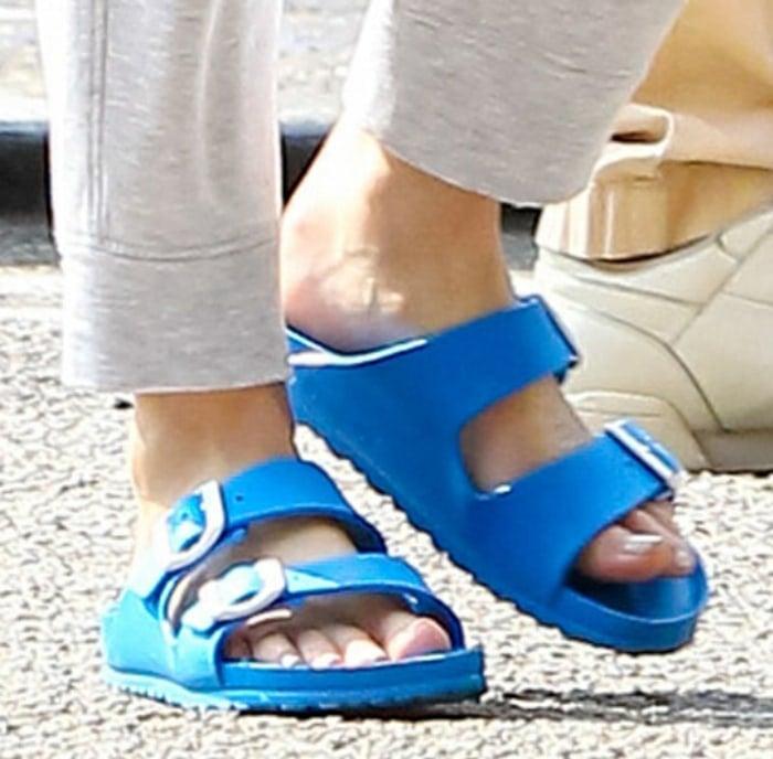 Whitney Port in a pair of Birkenstock Arizona EVA sandals