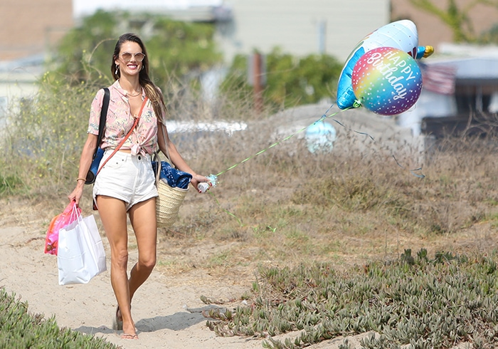 Alessandra Ambrosio picks up some party supplies before heading to the beach