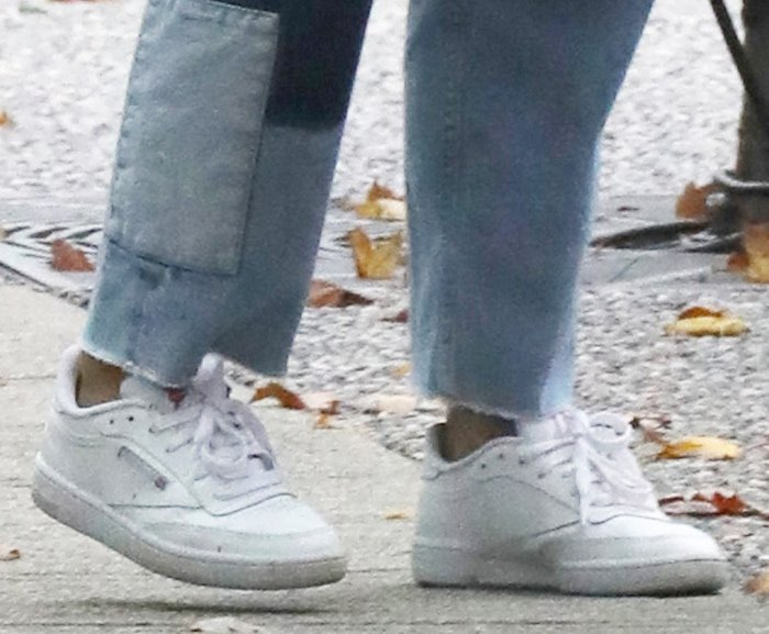 Camila Mendes slips into a pair of the iconic Reebok Club C sneakers