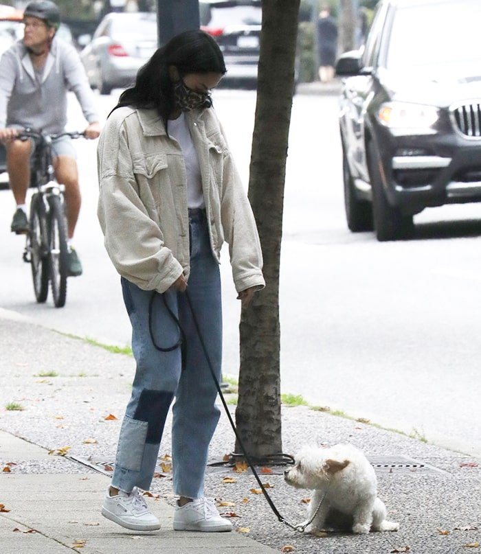 Camila Mendes takes her Maltipoo dog, Truffle, out for a walk in Vancouver, Canada on October 1, 2020